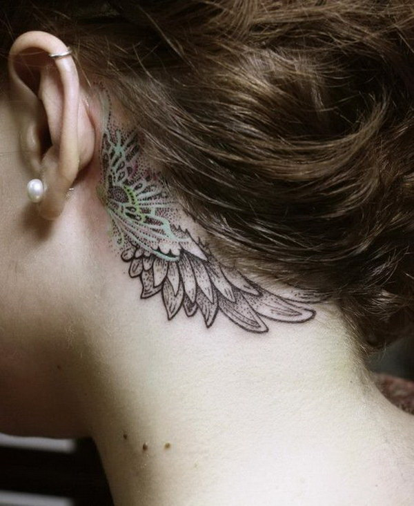 Beautiful Wingshaped Tattoo Behind Ear.
