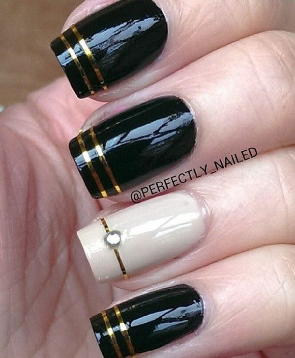 Black Nail Art Design with Gold Stripes for Detail.