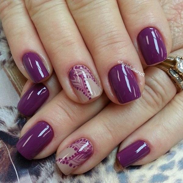 Elegant Purple Nails with Delicate Designs.