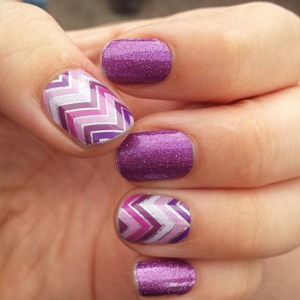 Purple Nail Design with Chevron Patterns.