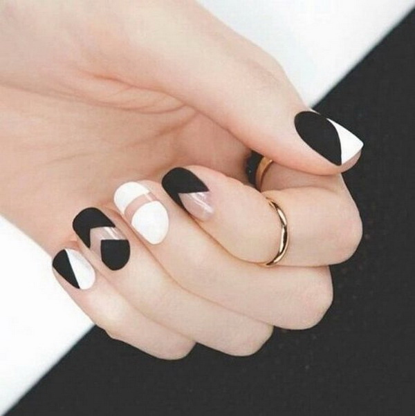 Matte Black and White Negative Space Nail Art.
