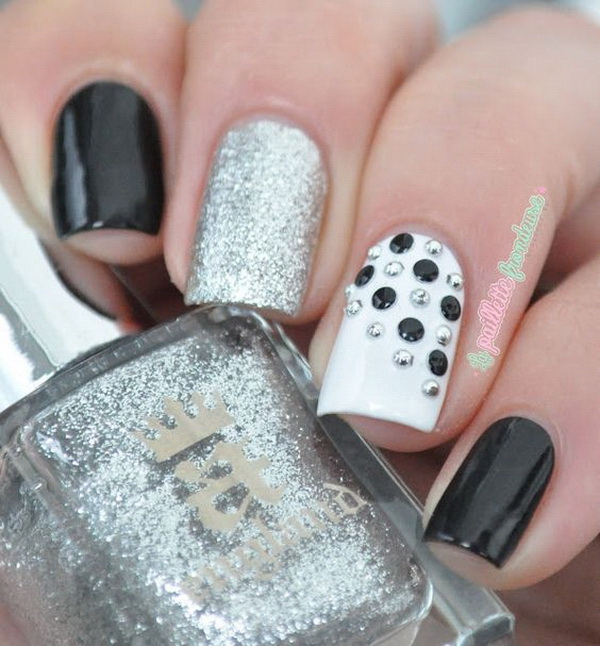 Black and white nail art for feet : Black and white with silver studs accent nail art
