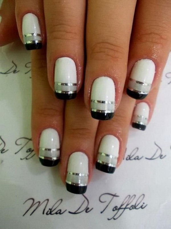 Black And White French Nails With Silver Metallic Strips For Effect.