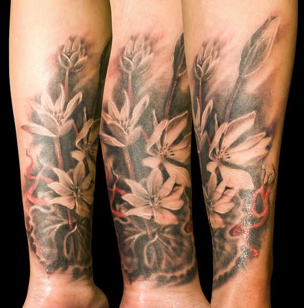 Floral Forearm Tattoo for Men or Women.What a cool tattoo design idea!  Love it very much! This will be my next tattoo design. via http://forcreativejuice.com/awesome-forearm-tattoo-designs/