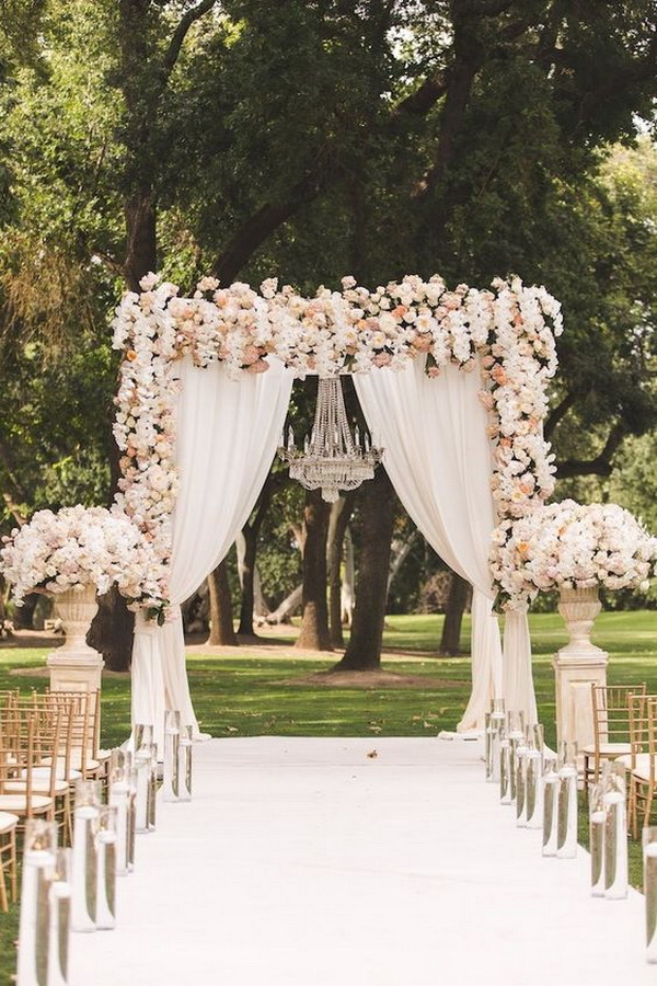 Gorgeous Floral Wedding with A Chandelier in Center.