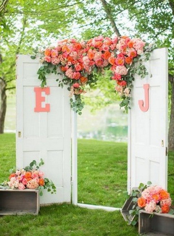 Arch decorations ideas my web value vintage doors and lush florals for a wedding arch what a beautiful wedding arch decoration junglespirit Choice Image