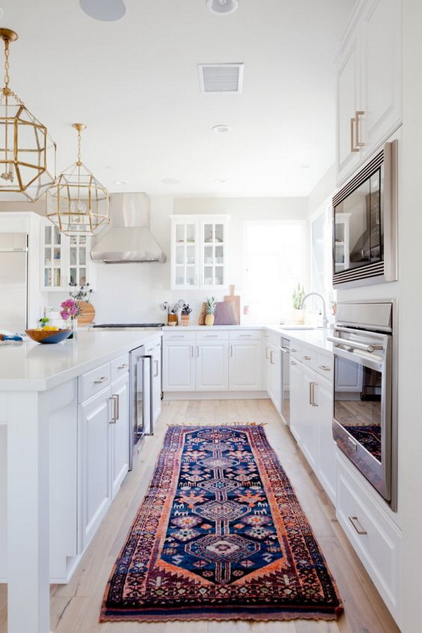 White kitchen paired with runner and copper finishes.  More via https://forcreativejuice.com/elegant-white-kitchen-interior-designs/