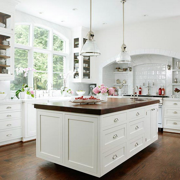 Causal but sophisticated white kitchen with walnut accents. More via https://forcreativejuice.com/elegant-white-kitchen-interior-designs/