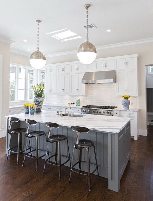 Classic White Kitchen With White Cabinets, Darker Floors,gray Island And  The Modern Pendants