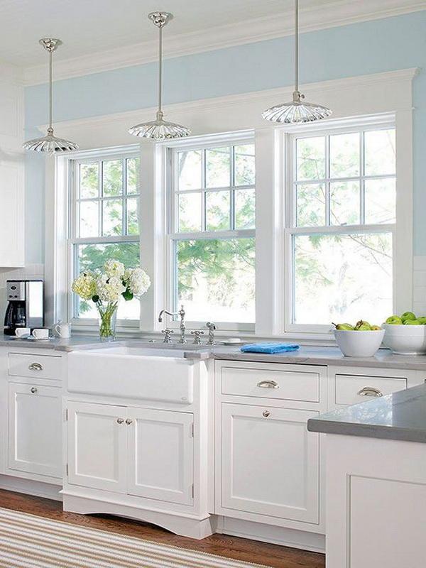 Bright white kitchen with the large windows. More via https://forcreativejuice.com/elegant-white-kitchen-interior-designs/