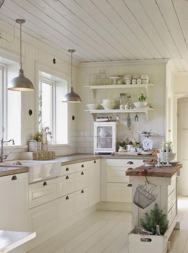 Farmhouse white kitchen with a rustic wood topped island. More via https://forcreativejuice.com/elegant-white-kitchen-interior-designs/