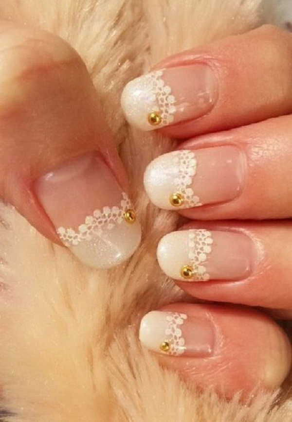 White lace nails with gold beads on for accent. This is perfect for bridal wedding nail design.