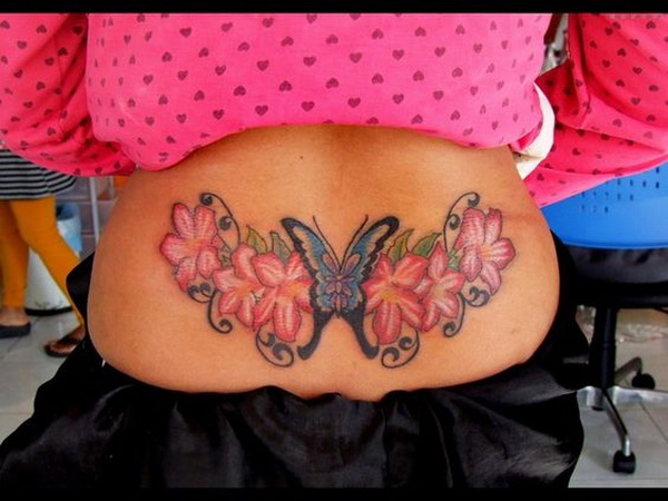 Butterfly and Flower Tattoo On Lower Back.