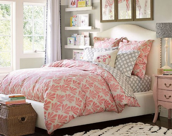 Light and airy bedroom with vibrant tone. Grey, pink, white color scheme and everything in this girls' bedroom go well with each other, the triptych wall art, Moroccan-inspired rug and curtains, elephant motif throw pillow...