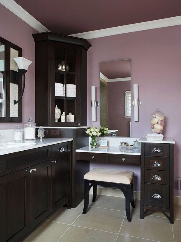 Interesting color combination for bathroom: light purple walls and dark brown painted cabinets.