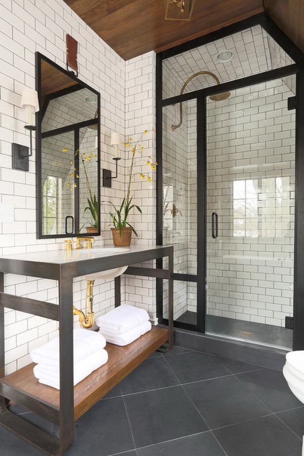 Industrial-style bathroom with white subway tiles and dark grout.