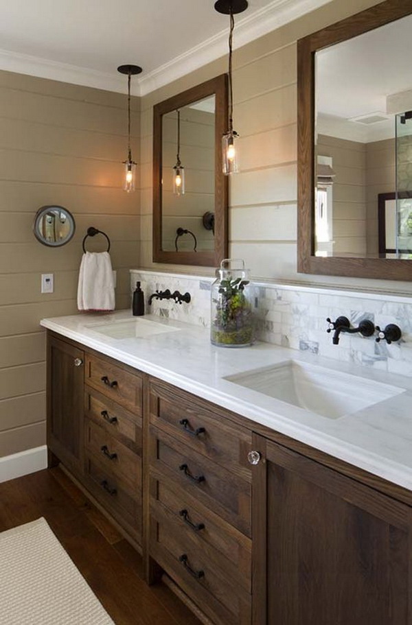 Inspiration for a farmhouse bathoom design with dark wood cabinets and framed mirrors.