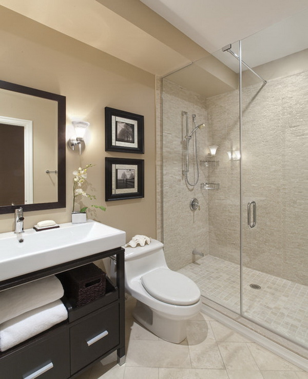 Contemporary bathroom with a vessel sink, glass shower wall...