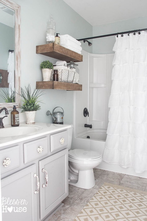 Modern Farmhouse Bathroom with Wood Floating Shelves.