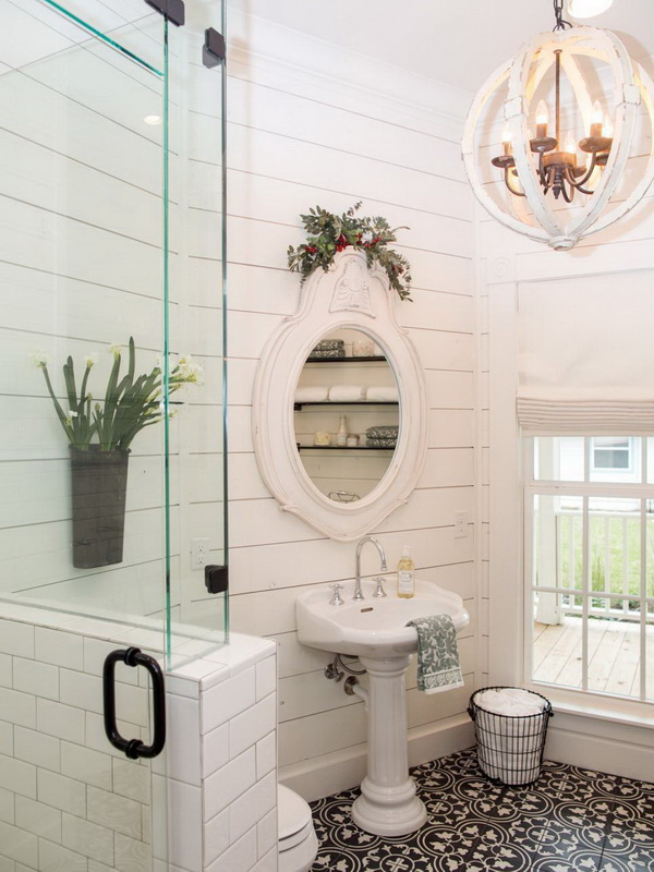 Totally love the farmhouse style and the shabby chic look and the stenciled floor of this bathroom.