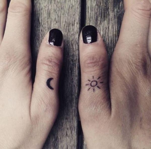 Tiny Sun and Moon Finger Tattoo.