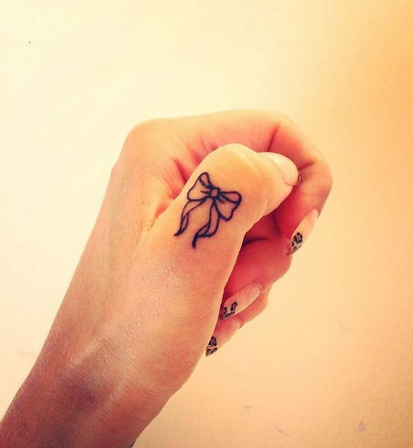 Cute Bow Finger Tattoo.
