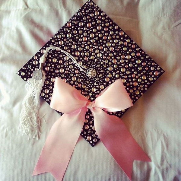 Bedazzled Graduation Cap with a Pink Bow---40+ Awesome Graduation Cap Ideas.