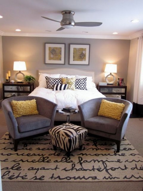 Gray Walls and white beddings for a Master bedroom design.