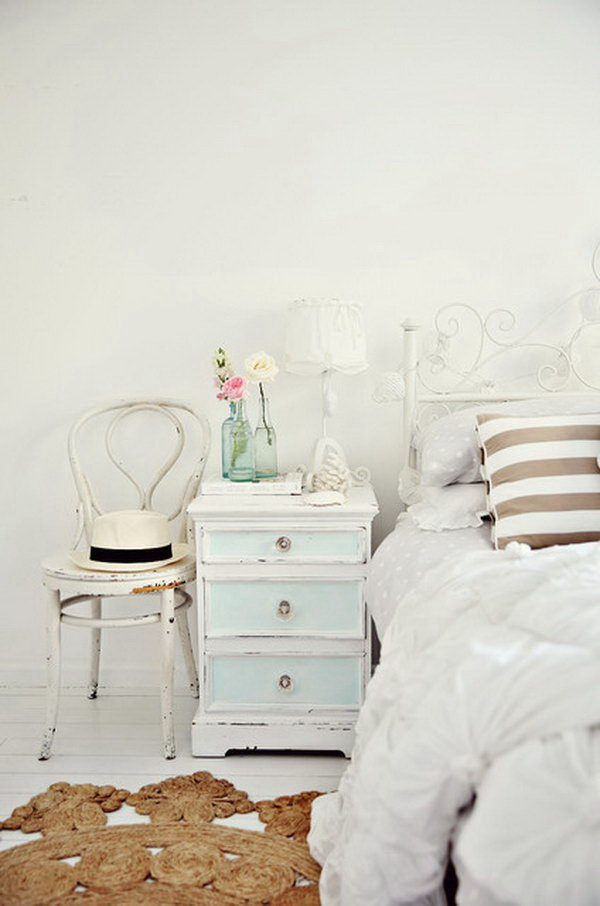 Shabby Chic Bedroom with White Walls, Vintage Nightstand and Light Hardwood Floors.