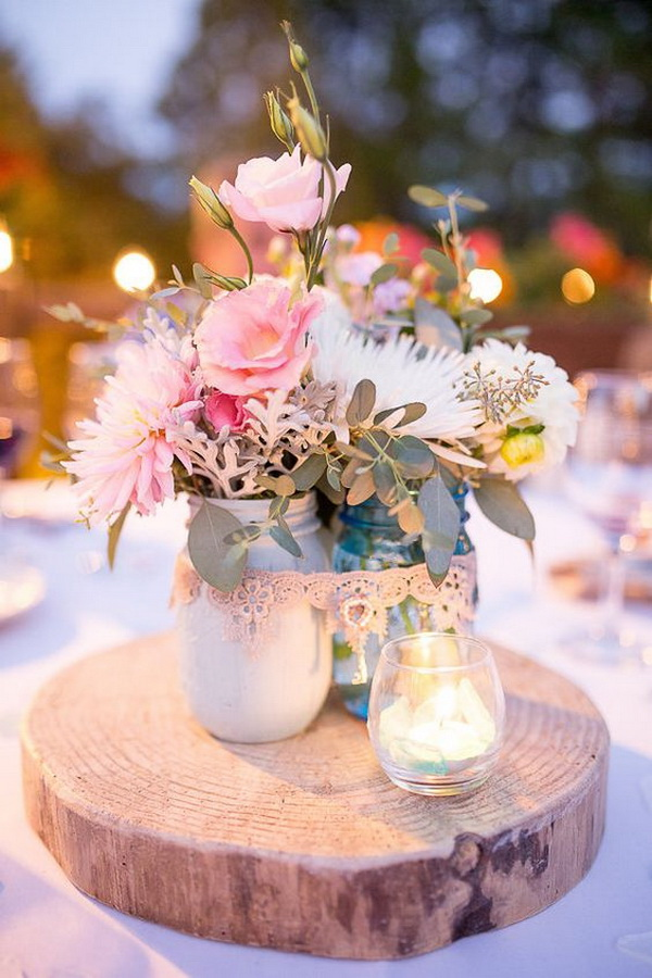 Shabby Chic Wedding Centerpiece with Flowers in Mason Jars.