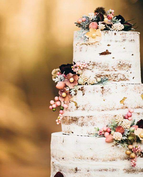 Shabby Chic Wedding Cake with Its barely-there icing and Delicately Placed Buds.