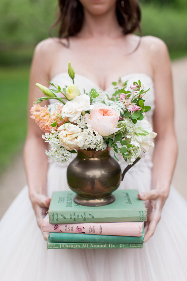 Vintage Shabby Chic Wedding Decoration with Old Books and Flower Vases.