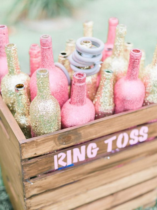 Pink and Gold Glitter Wine Bottles in Rustic Wood Crates for Wedding Decor.
