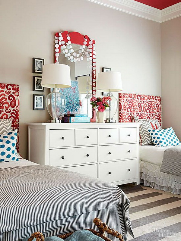 Add colors against the neutral walls with the pretty headboard.