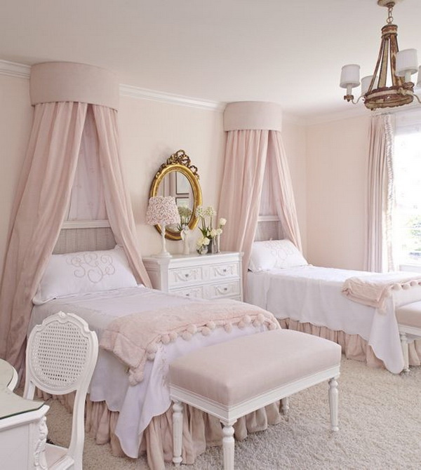 Dreamy pink shared bedroom with canopies.