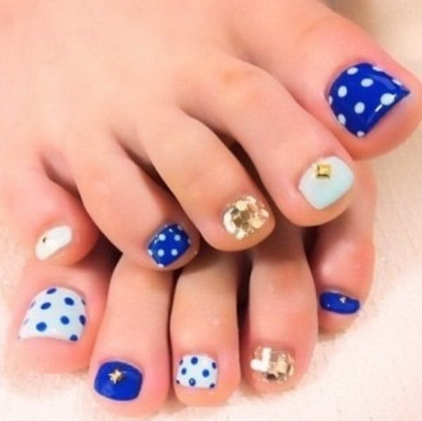 blue polish with polka dots glitter and jewels toe nail design - Toe Nail Designs Ideas