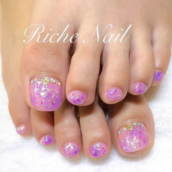Purple Nail Polish with Gems and Rhinestones.