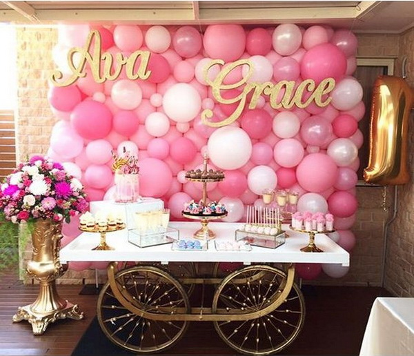 pretty in pink balloon backdrop decoration for birthday party