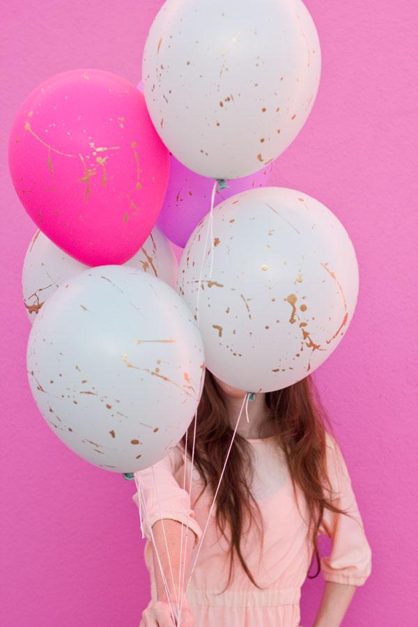 DIY Gold Splatter Paint Balloons.