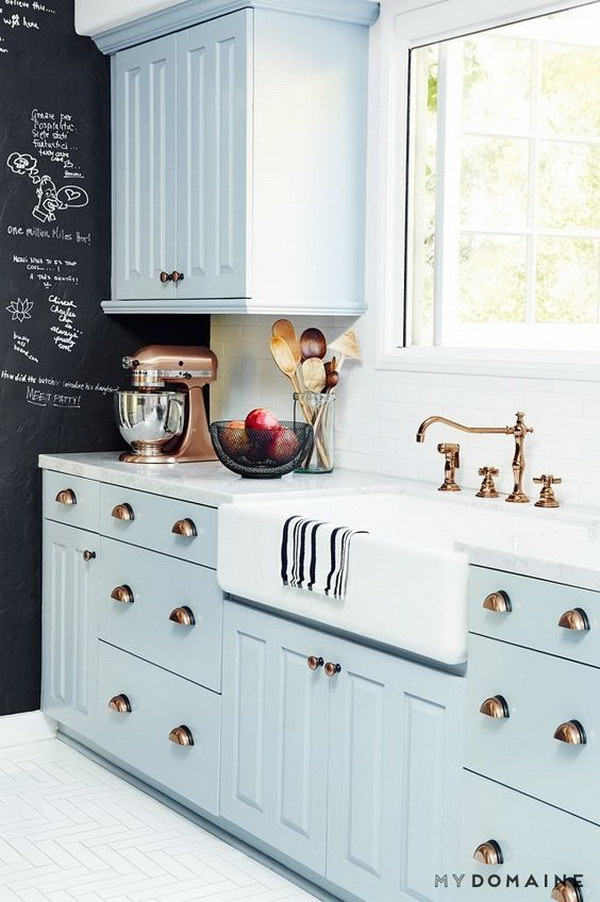 Baby Blue Kitchen Cabinets with Brass Hardware and White Subway Tiles.