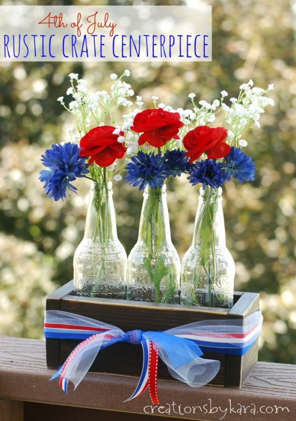 This rustic crate filled with flowers makes an easy and lovely 4th of July Centerpiece!