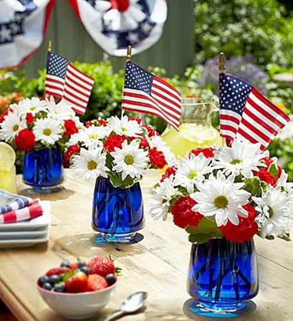 July 4th Themed Vases Filled with Blue Food Coloring and Fresh Flowers.