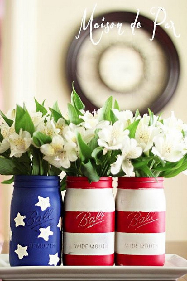 "What to say ""Happy Birthday, America"" better than these American flag painted mason jars? Super easy to make! Just spray paint the mason jars red, blue and white with stars and strips and then fill in some white fresh flowers!"