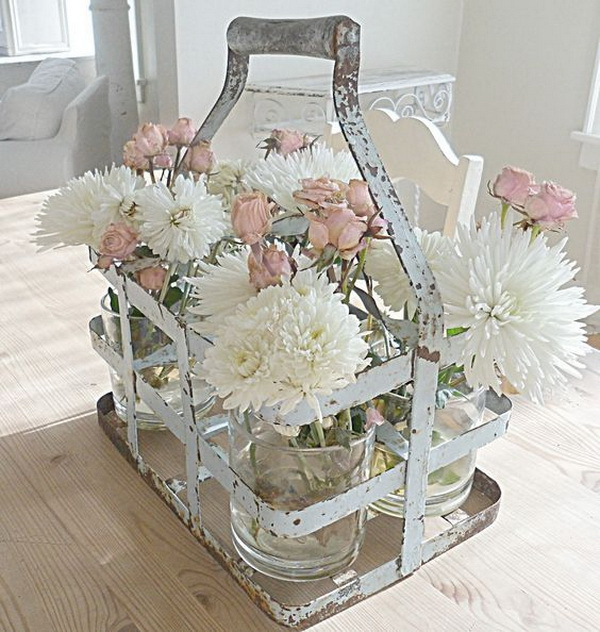 Vintage Milk Jug Carrier with Mason Jars and Fresh Flowers in for Kitchen Table Decoration.