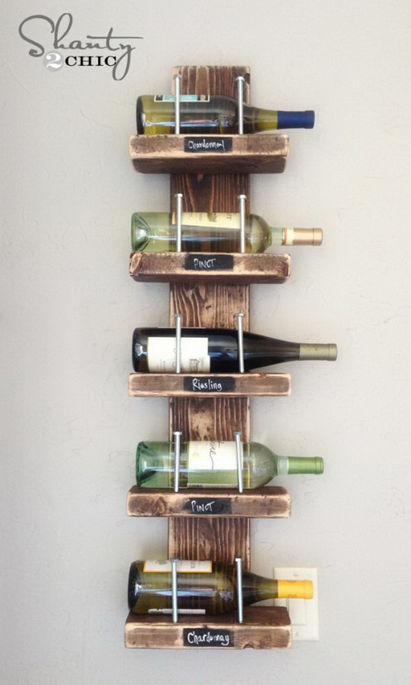 DIY Verticle Wooden Wine Shelf. This simple rustic chic wine rack can be made for under $15 and serves as a great rustic decor piece for your home!