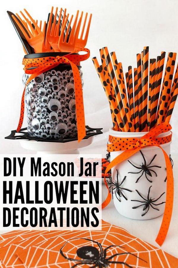 DIY Mason Jar Halloween Decorations. Decorate mason jars with the spooky black spiders and funny googly eyes.