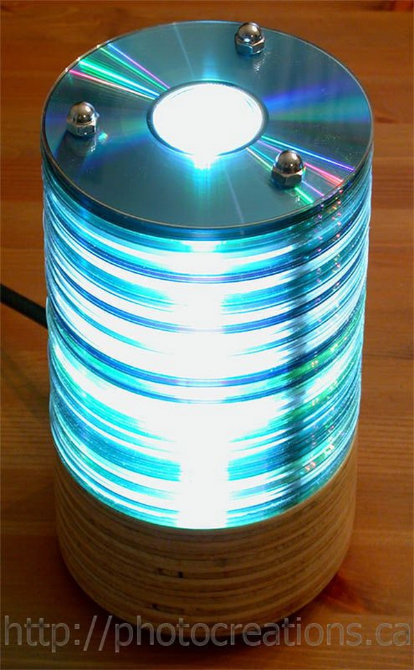 Recycled CD Lamp. A stack of CDs with a tubular light inside would make an awesome lamp.