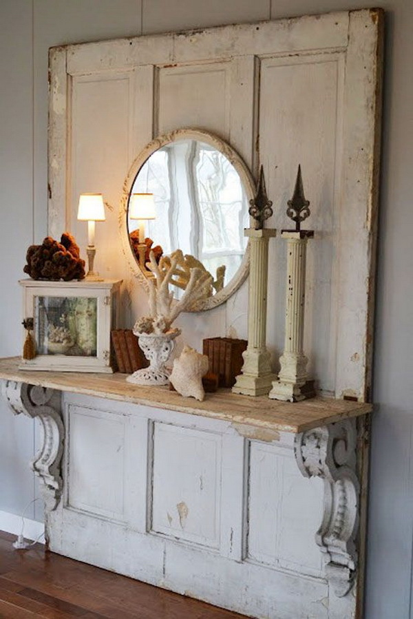 Cute shabby chic entryway decoration with old wood doors.