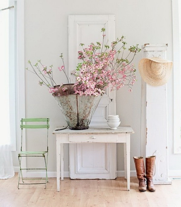 Vintage Farmhouse Entryway Decor. An old wooden door, a distressed console table with beautiful pastel fresh flowers in the repurposed bucket for a casual elegance!