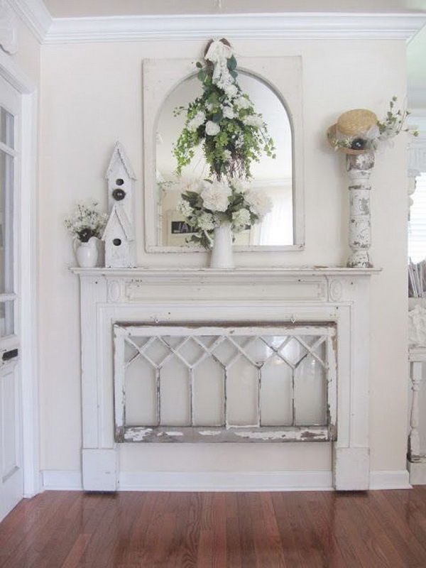Vintage white shabby chic entryway! A beautiful but reserved vignette made with old windows, fireplace mantel,etc.